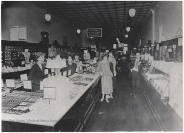 Employees pose inside the shop located on Temple Street.