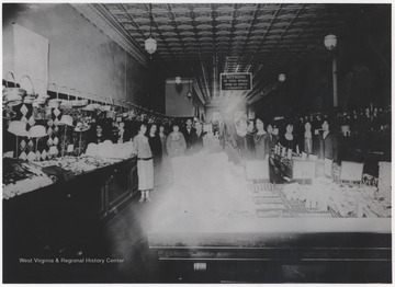 "Shoppers pictured inside the department store, where a sign insists that ""nothing in this store is over 10 cents."""