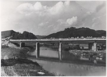 People gather to observe the newly constructed bridge.