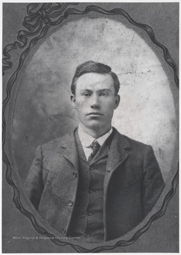 Portrait of Quisenberry who is dressed in a suit.