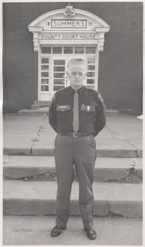 Shanklin pictured in uniform in front of the Summers County Court House.