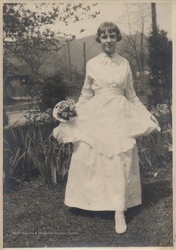 Hinton wears what is the oldest wedding dress in Hinton, first worn on December 27, 1871 when Mary Jane Charlton married Galon Silas Hinton.