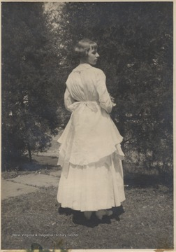 Hinton pictured in the oldest wedding dress in Hinton, which was first worn on December 27, 1871 when Mary Jane Charlton married Galon Silas Hinton.