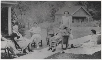 Pictuerd from left to right is Jessie Lois, Ada Neely, Trusby Neely, Grandmother Clara Meador Lilly, unidentified, and Aunt Gussie.