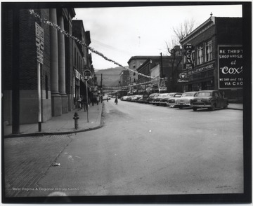View from the corner of Temple Street and 2nd Avenue, streamers zig-zag across the streets.