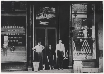 Located at 304 3rd Avenue, Clyde Harford (right) and associates stand outside of the first ever Kroger Grocery & Baking Company store to enter the city. J. E. Garrettson served as the store's manager. The store later became Bowlings Dairy Bar.
