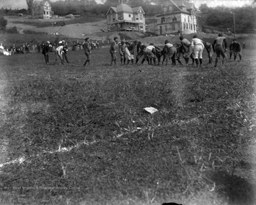 The W.V.U. football team plays against Geneva at a game in Morgantown, W. Va. in October of 1896