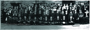A group portraits outside of the high school building. Subjects unidentified.