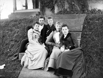 Group of unidentified people, likely West Virginia University students, pose for a portrait on steps.