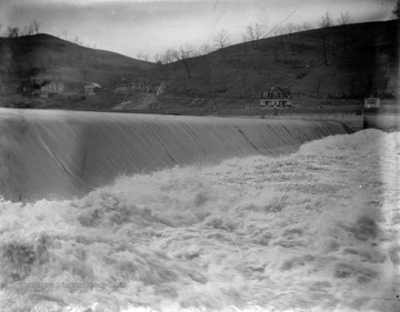View of water rushing over dam.