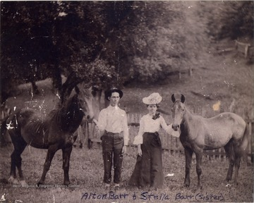Alton Barr, father of Pauline Barr Sirk, and his sister, Stella Barr, pose with horses.