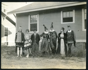 Unidentified group of people pose for photo in their masquerade costumes in the town of Nitro, W. Va..