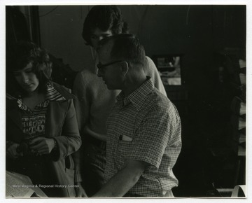 "Woodrow ""Woody"" Wilson, owner of the Wirt County Journal, talks to two unidentified students at the office of the Wirt County Journal in Elizabeth, West Virginia.The photos in this collection were used in chapters that appeared in Mountain Trace, a publication of Parkersburg High School in West Virginia, edited by Kenneth G. Gilbert."