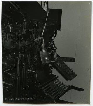 "A linotype machine involved in the newspaper operation at the Wirt County Journal in Elizabeth, W. Va. owned by Woodrow ""Woody"" Wilson.The photos in this collection were used in chapters that appeared in Mountain Trace, a publication of Parkersburg High School in West Virginia, edited by Kenneth G. Gilbert."