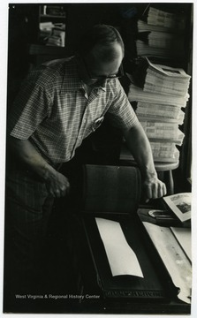"Woodrow ""Woody"" Wilson, owner of the Wirt County Journal, in the office of the newspaper in Elizabeth, W. Va.The photos in this collection were used in chapters that appeared in Mountain Trace, a publication of Parkersburg High School in West Virginia, edited by Kenneth G. Gilbert."