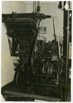 A linotype machine used when printing newspapers at the Wirt County Journal in Elizabeth, W. Va.The photos in this collection were used in chapters that appeared in Mountain Trace, a publication of Parkersburg High School in West Virginia, edited by Kenneth G. Gilbert.
