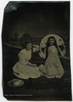 Portrait of Edith Woodcock (on the right) and an unidentified girl from a photograph album of late nineteenth century images featuring residents from Keyser, W. Va.