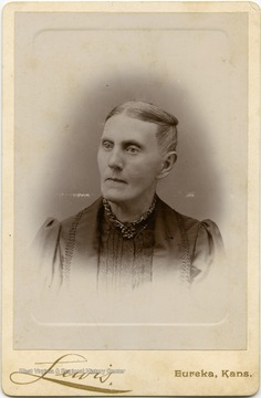 "Portrait of Sarah Murray Woodcock, likely a resident of Keyser, W. Va., taken in Eureka, Kansas from a photograph album of late nineteenth century images featuring residents from Keyser, W. Va.  Written on the back of the image are the words ""For Aunt Jane."""