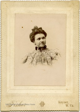 "Portrait of Nancy Lauck from a photograph album of late nineteenth century images featuring residents from Keyser, W. Va.  ""Mrs. Wm. MacDonald, Nancy J. Lauck, married Wm. MacDonald Attorney at Law, Keyser, W. Va."""