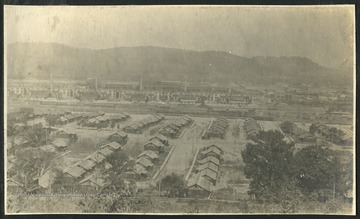 View of homes and factories in Nitro, a town created during WWI in 1917 to produce gunpowder for the war effort. The gunpowder factories are visible in the distance.