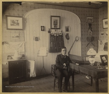 McDaniel is pictured sitting at a table. The photo is from a photograph album of late nineteenth century images featuring residents from Keyser, W. Va.