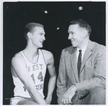 West, left, and Schaus, right, are pictured together smiling.
