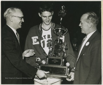 West played as East Bank High School's small starting forward. He led his team to secure its first ever state championship title.He was named All-State from 1953–56, then All-American in 1956 when he was West Virginia Player of the Year, becoming the state's first high-school player to score more than 900 points in a season.
