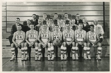In the front row is Jim Warren, Paul Miller, Willie Akers, Jerry West, Joe Posch, Jim Ritchie, and Lee Patrone.In the middle row is Coach Fred Schaus, Asst. George King, Ed Bode, Nick Serdich, Kenny Ward, Butch Goode, freshman coach Quentin Barnette, and trainer Whitey Gwynne.In the back row is manager Tony Minard, Dick DuBois, Nick Visnic, Paul Popovich, and equipment custodian Carl Roberts.