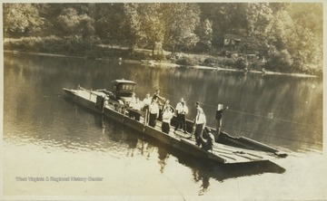 A boat transporting unidentified people crosses the Cheat River.