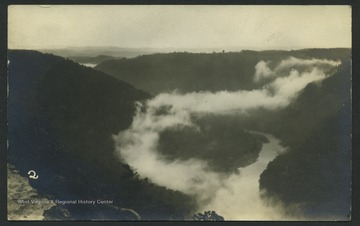 View of the Cheat River with mist on the mountains from Coopers Rock overlook in Cooper's Rock State Forest, W. Va..
