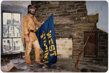 West Virginia University's 1986-1987 mascot poses in a building in the Old Mountaineer Field before the demolition in 1987.