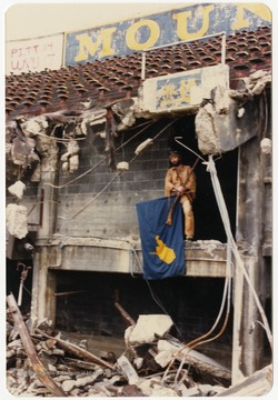 West Virginia University's 1986-1987 mascot poses during the Old Mountaineer Field demolition.