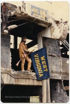 West Virginia University's 1986-1987 mascot poses at the Old Mountaineer Field demolition site.