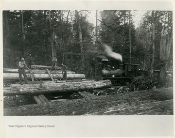 This image is part of the Thompson Family of Canaan Valley Collection. The Thompson family played a large role in the timber industry of Tucker County during the 1800s, and later prospered in the region as farmers, business owners, and prominent members of the Canaan Valley community.Men are seen loading spruce logs for transportation to the mill. The engine seen was the first shay locomotive, number 142, on Thompson job.