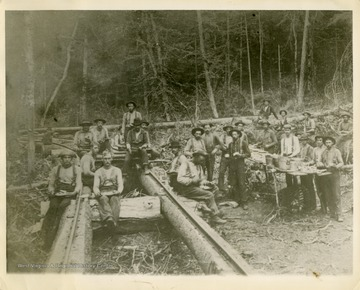 This image is part of the Thompson Family of Canaan Valley Collection. The Thompson family played a large role in the timber industry of Tucker County during the 1800s, and later prospered in the region as farmers, business owners, and prominent members of the Canaan Valley community.The crew takes a meal break from building the Stringer Rail Road.