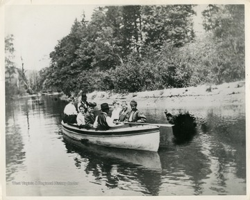 This image is part of the Thompson Family of Canaan Valley Collection. The Thompson family played a large role in the timber industry of Tucker County during the 1800s, and later prospered in the region as farmers, business owners, and prominent members of the Canaan Valley community.Unidentified people boating on Blackwater River during a Sunday afternoon.