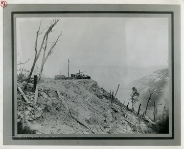 This image is part of the Thompson Family of Canaan Valley Collection. The Thompson family played a large role in the timber industry of Tucker County during the 1800s, and later prospered in the region as farmers, business owners, and prominent members of the Canaan Valley community.A skidder set, used for logging and lumber production, can be seen here overlooking the Blackwater Canyon.