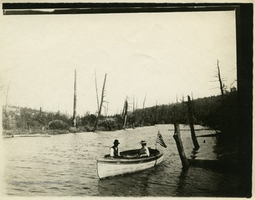 This image is part of the Thompson Family of Canaan Valley Collection. The Thompson family played a large role in the timber industry of Tucker Country during the 1800s, and later prospered in the region as farmers, business owners, and prominent members of the Canaan Valley community.Geo. [George] and Elsie Thompson canoe above the Splash Dam on the Blackwater River.