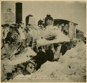 This image is part of the Thompson Family of Canaan Valley Collection. The Thompson family played a large role in the timber industry of Tucker Country during the 1800s, and later prospered in the region as farmers, business owners, and prominent members of the Canaan Valley community.The snow encased train engine was traveling between Thomas and Davis between February 1st and 4th, 1908.