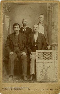 In the Front Row is F. Boxter and an unidentified gentleman. Pictured standing from left to right are Owen McCullough on the left and an unidentified gentleman to the right.This image is part of the Thompson Family of Canaan Valley Collection. The Thompson family played a large role int he timber industry of Tucker County during the 1800s, and later prospered in the region as farmers, business owners, and prominent members of the Canaan Valley community.