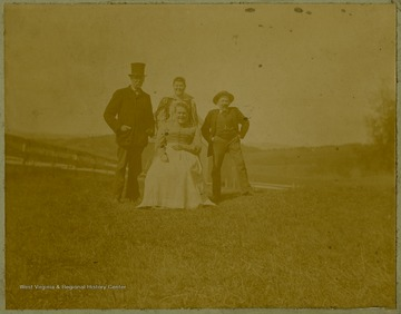 Albert Thompson is pictured on the left with three unidentified associates.Albert Thompson brought the Thompson family to West Virginia and Tucker County in the late 1800s with the booming timber industry, taking advantage of Tucker County's forests. He bought the J. L. Rumbarger Lumber company and established the Thompson Lumber Company, which later became the Blackwater Boom and Lumber Company.This image is part of the Thompson Family of Canaan Valley Collection. The Thompson family played a large role in the timber industry of Tucker County during the 1800s, and later prospered in the region as farmers, business owners, and prominent members of the Canaan Valley community.