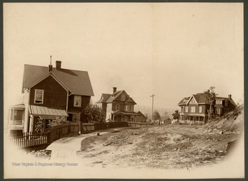 From left to right is the C. I. Pell House (later Robert T. Barton's home), the company House of Beech Burgen, the F. S. Landstreet House, and the Allegheny Heights Hospital, later the site of the Coffman House.This image is part of the Thompson Family of Canaan Valley Collection. The Thompson family played a large role in the timber industry of Tucker County during the 1800s, and later prospered in the region as farmers, business owners, and prominent members of the Canaan Valley community.