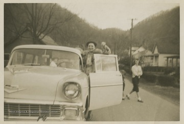 Williams holds up the keys to a brand new Chevy station-wagon, which was bought for basketball coach Roy Williams and his family by the East Bank High School fans.Jerry West led the East Bank High School basketball team to its first ever West Virginia state championship title in 1956.