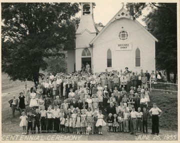 "The Evangelical United Brethren church was organized in 1854.The caption written on the back of the image reads:""First row of adults, left to right: A.J. Summers, retired M.E. Minister; Rev. Donald Lockhart - the pastor in 1955; Dr. J.L. Miles E.U.B. Conference Superintendent in 1955.Just behind and to the left are two former pastors of our church, left to right: Paul Brake, Rev. E.A. Crites of Bridgeport, W. Va."""