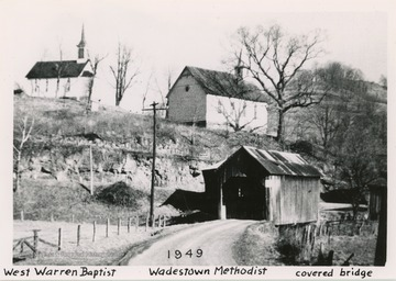The two churches of different denominations stand next to each other on a hill above a covered bridge. West Warren Baptist is on the left, Wadestown Methodist is in the middle, and in the lower right of the image is the covered bridge.