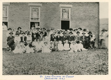 A group of church members sit for a portrait at the new building for St. Luke Church of Christ. The date the church was organized is unknown, but likely between 1860 and 1870.  A frame church was built in 1890 but destroyed by fire in 1913.  The name then changed to St. Luke Christian Church and a new building was erected in 1918.