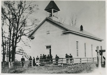 A group of church m embers are gathered outside of the building which was built in 1880. The organization was established in 1847.