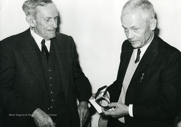 A medal presentation to Edward C. Tabler by the Rhodesia Pioneers' and Early Settlers' Society, at Bulawayo, Zimbabwe, Africa.