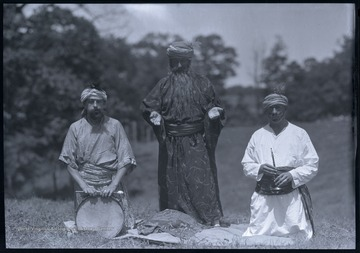 The men, which are all unidentified, pose together in their costumes.