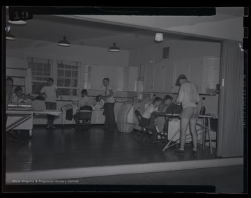 Campers work in the kitchen for a class at an unidentified 4-H camp location.